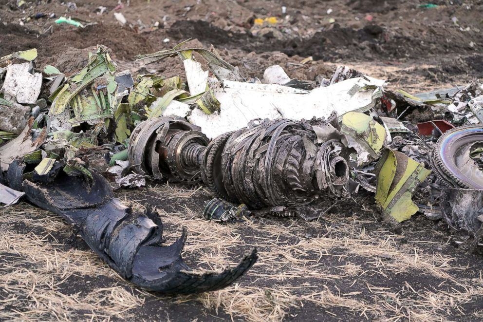 Parts of an engine and landing gear lie in a pile after being gathered by workers during the continuing recovery efforts at the crash site of Ethiopian Airlines flight ET302 on March 11, 2019 in Bishoftu, Ethiopia.