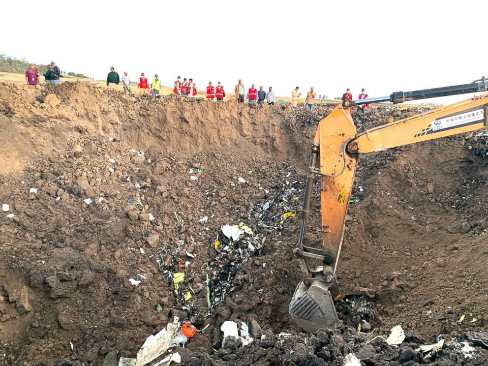 PHOTO: An excavator works at the crash site of an Ethiopian Airlines aircraft near Addis Ababa, capital of Ethiopia, March 10, 2019.