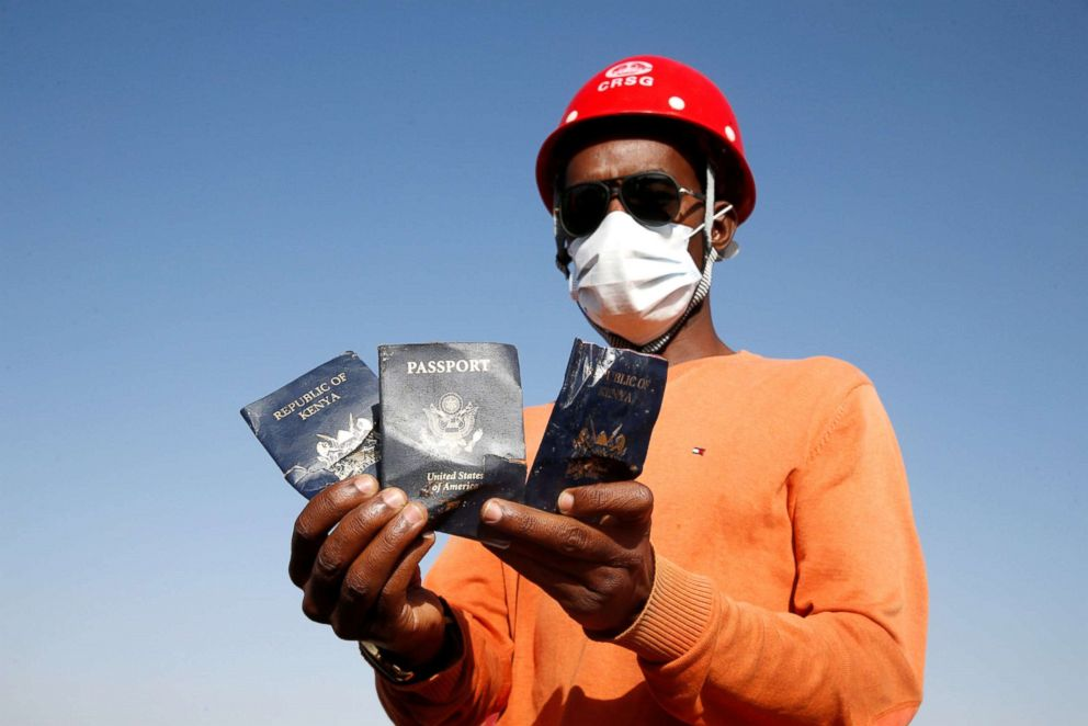 A man holds passengers' passports found at the scene of the Ethiopian Airlines Flight ET 302 plane crash, near the town of Bishoftu, Ethiopia, March 12, 2019.