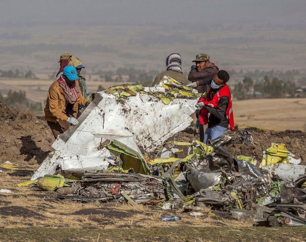 PHOTO: In this March 11, 2019, rescuers work at the scene of an Ethiopian Airlines flight crash near Bishoftu, or Debre Zeit, south of Addis Ababa, Ethiopia.