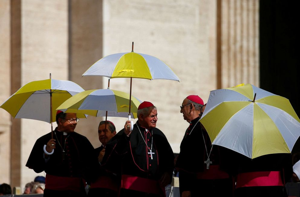 PHOTO: Members of the clergy hold umbrellas ahead of the general audience in St. Peters Square, at the Vatican, June 26, 2019.