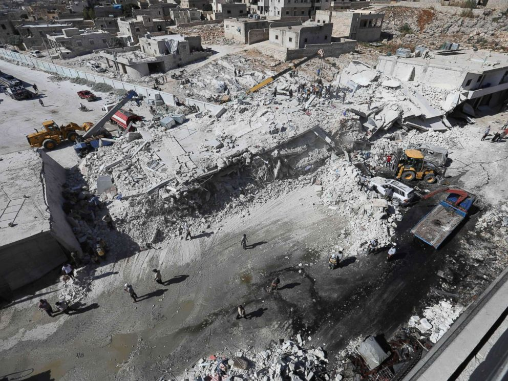 PHOTO: Destroyed buildings are seen on Aug. 12, 2018 following an explosion at an arms depot in a residential area in Syrias northern Idlib province city of Sarmada.