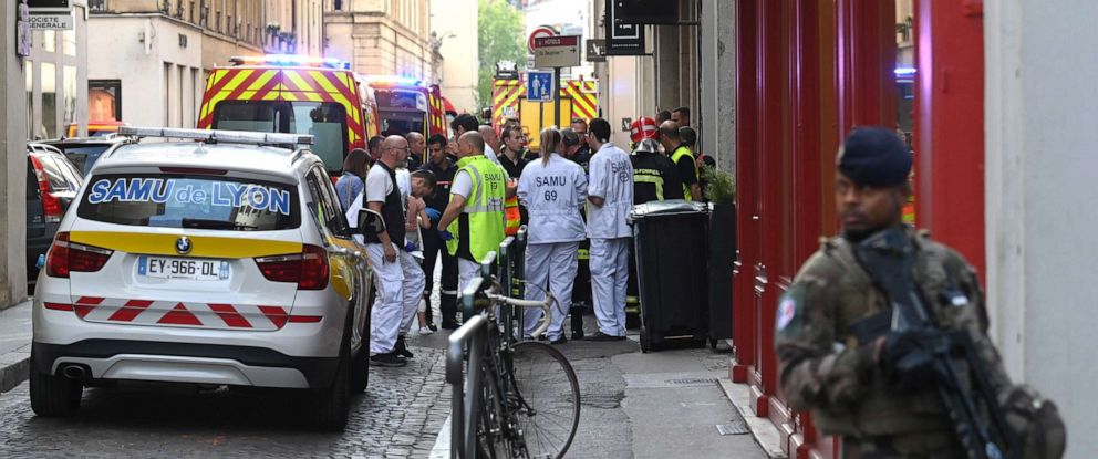 PHOTO: French security and emergency workers block the area following a suspected package bomb blast along a pedestrian street in the heart of Lyon, southeast France, the local prosecutors office said, May 24, 2019.