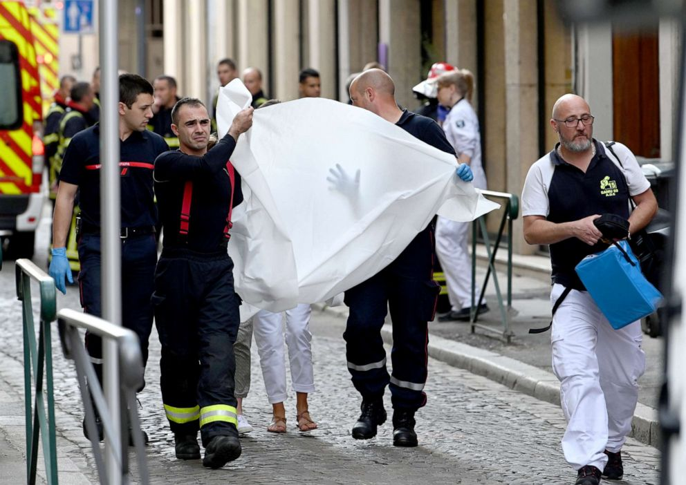 PHOTO: Emergency workers carry a person injured in suspected package bomb blast along a pedestrian street in the heart of Lyon, southeast France, the local prosecutors office said, May 24, 2019.