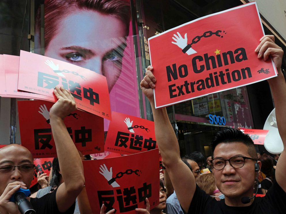 PHOTO: Demonstrators march during a protest to demand authorities scrap a proposed extradition bill with China, in Hong Kong, China, April 28, 2019.