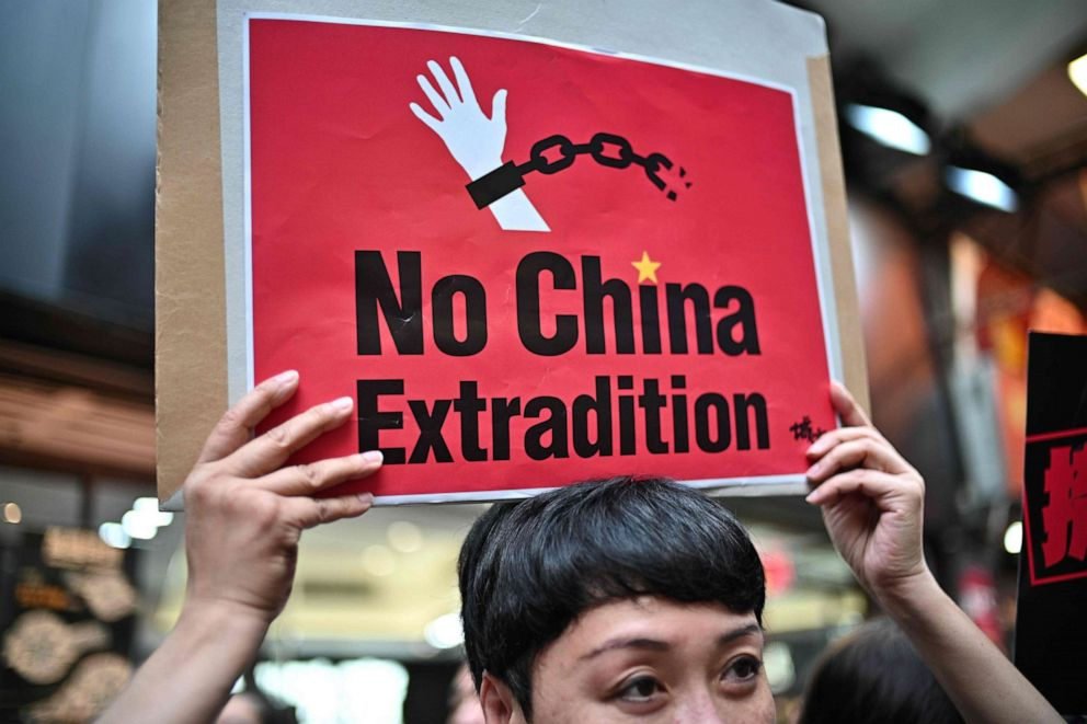PHOTO: A demonstrator holds a placard during a protest in Hong Kong, April 28, 2019, against a controversial move by the government to allow extraditions to the Chinese mainland.