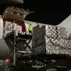 Medical supplies donated by China and its companies are unloaded from an airplane in Belgrade, Serbia, March 26, 2020.