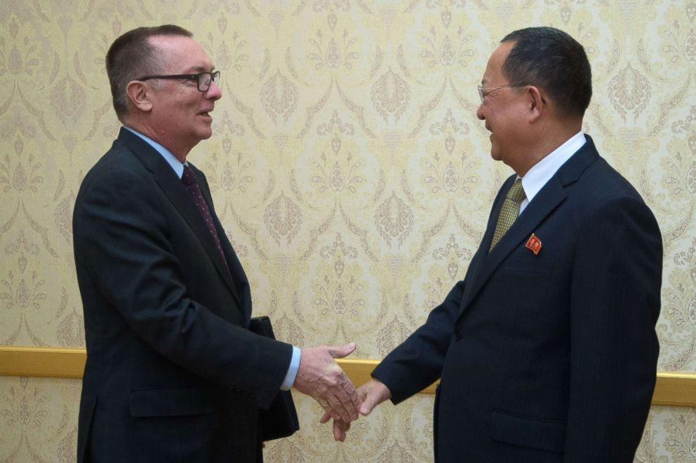 PHOTO: North Korean senior ruling party leader Ri Su-Yong (R) shakes hands with Jeffrey Feltman, the UNs under secretary general for political affairs, at Mansudae Assembly Hall in Pyongyang, Dec. 7, 2017.
