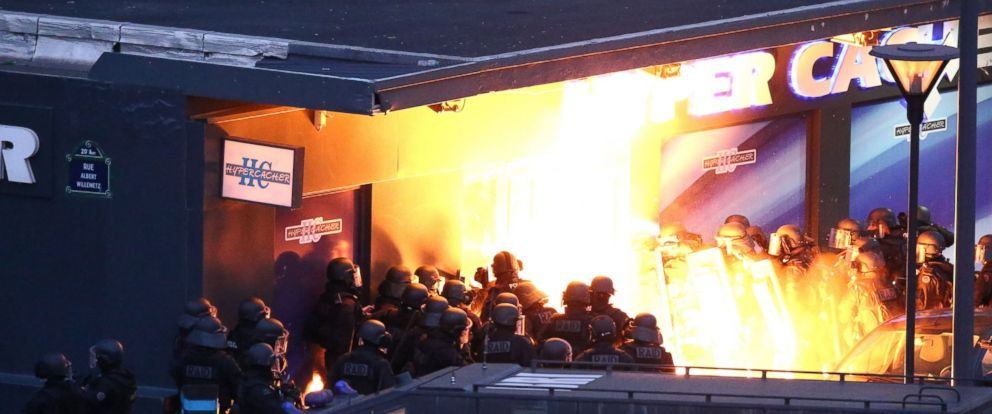 PHOTO: Police forces storm the Hyper Cacher kosher grocery store in Porte de Vincennes, eastern Paris, Jan. 9, 2015.