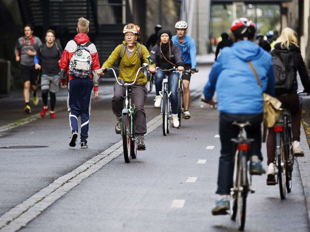 PHOTO: Cyclists and pedestrians pass the Baana road that was built on former train tracks and is now reserved for pedestrians and bicycles in Helsinki, Finland, Sept. 18, 2015.