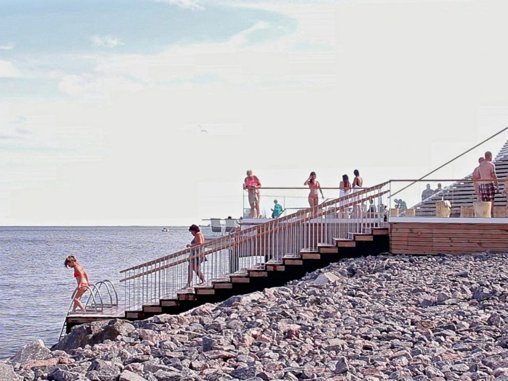 PHOTO: Sauna-goers dip in the Baltic Sea at a boutique sauna called Loyly in Helsinki, Finland, on July 7, 2016.