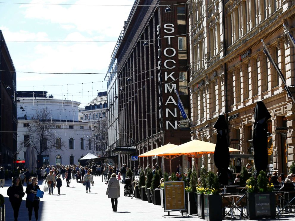 PHOTO: People walk past Stockmann shopping center in Helsinki, Finland, May 6, 2017.