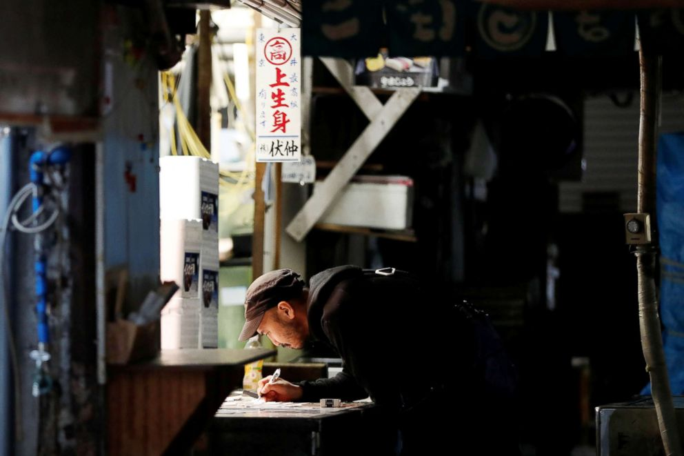 PHOTO: A wholesaler writes the days sales figures after trading ends at the Tsukiji fish market in Tokyo, Sept. 27, 2018.