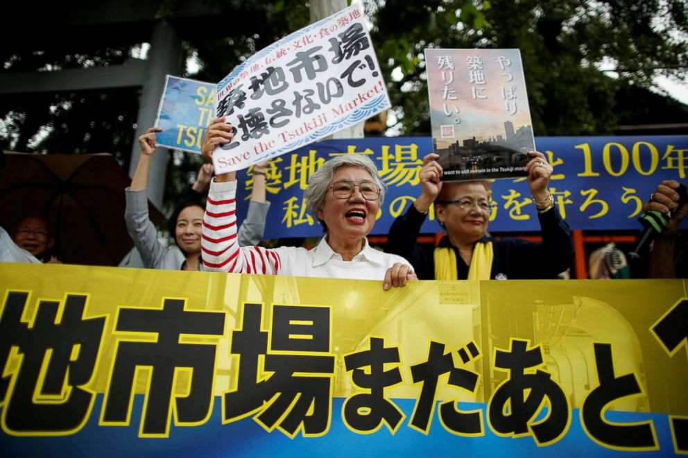 PHOTO: 75-year-old Tai Yamaguchi, who has been working at her familys fish shop for more than 50 years in Tukiji, takes part in a rally denouncing the markets relocation plan outside the Tsukiji market in Tokyo, Sept. 29, 2018.