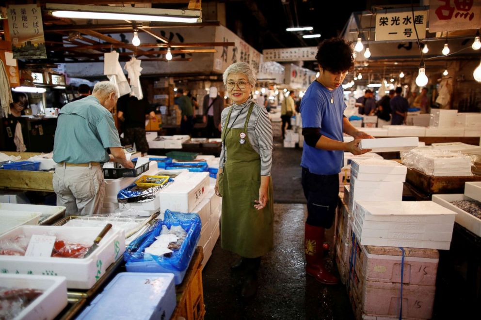 PHOTO: 75-year-old Tai Yamaguchi, who has been working at her familys fish shop for more than 50 years in Tukiji market, poses for a photograph at the Tsukiji fish market in Tokyo, Sept. 25, 2018.