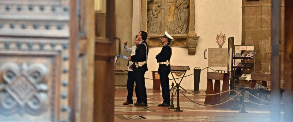 PHOTO: Police stand inside Santa Croce Basilica where a 52-year-old Spanish tourist was killed after being struck by a piece of masonary that fell off the top of a nave, Oct. 19, 2017, in Florence, Italy.
