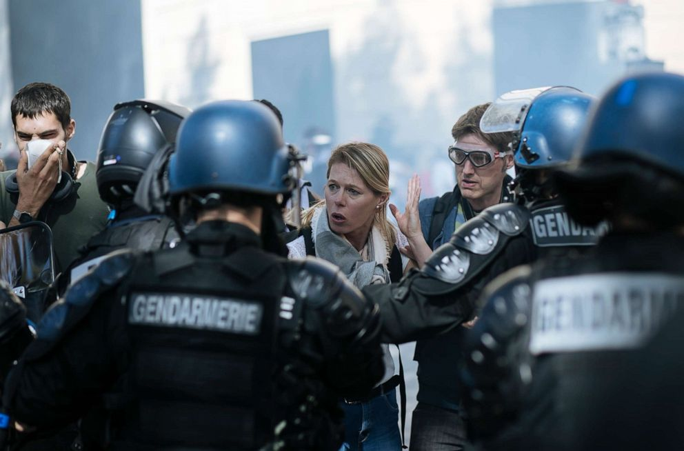 PHOTO: A woman gestures as she speaks with riot police officers during a yellow vests demonstration, in Paris, Saturday, Sept 21. 2019.
