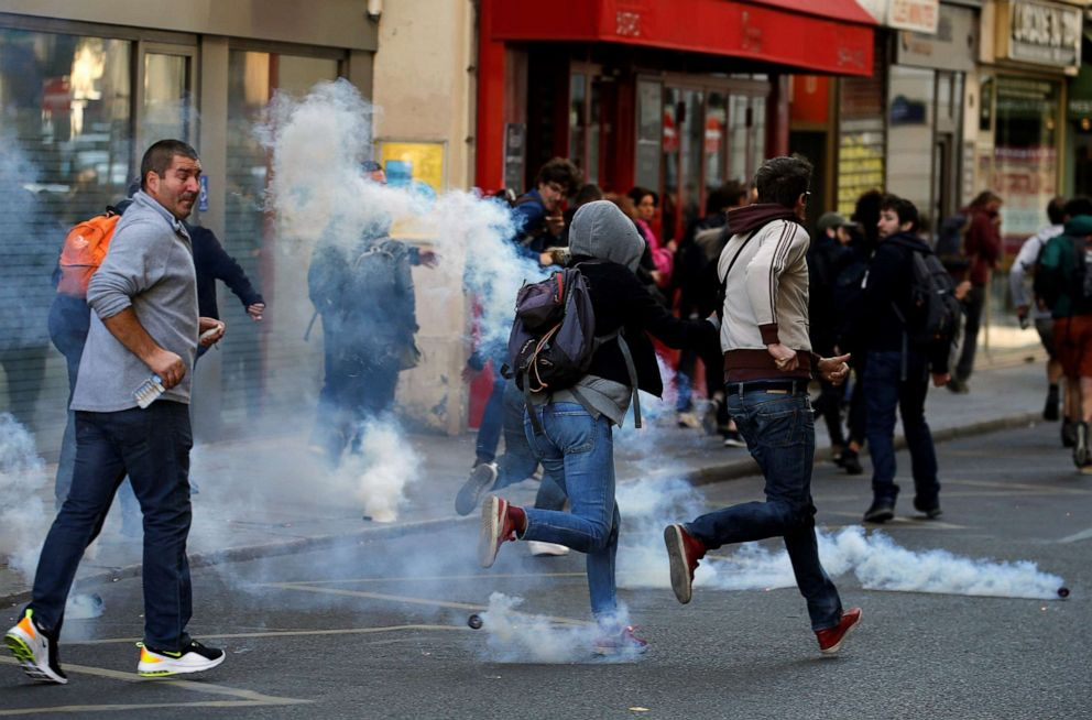 PHOTO: Protesters run away from tear gas during a demonstration on Act 45 (the 45th consecutive national protest on Saturday) of the yellow vests movement in Paris, France, September 21, 2019.