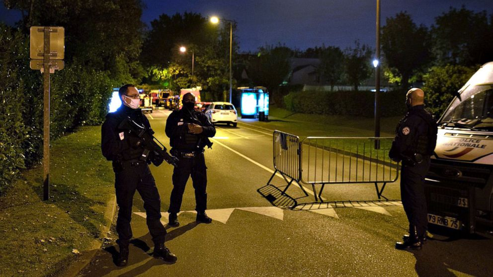PHOTO: Police officers stand guard a street in Eragny on Oct. 16, 2020, where an attacker was shot dead by policemen after he decapitated a man in Conflans-Sainte-Honorine, France.