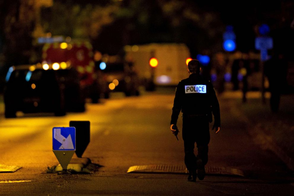 PHOTO: A police officer stands guard on a street on Oct. 16, 2020, where an attacker was shot dead by police after he decapitated a man in Conflans-Sainte-Honorine, France.