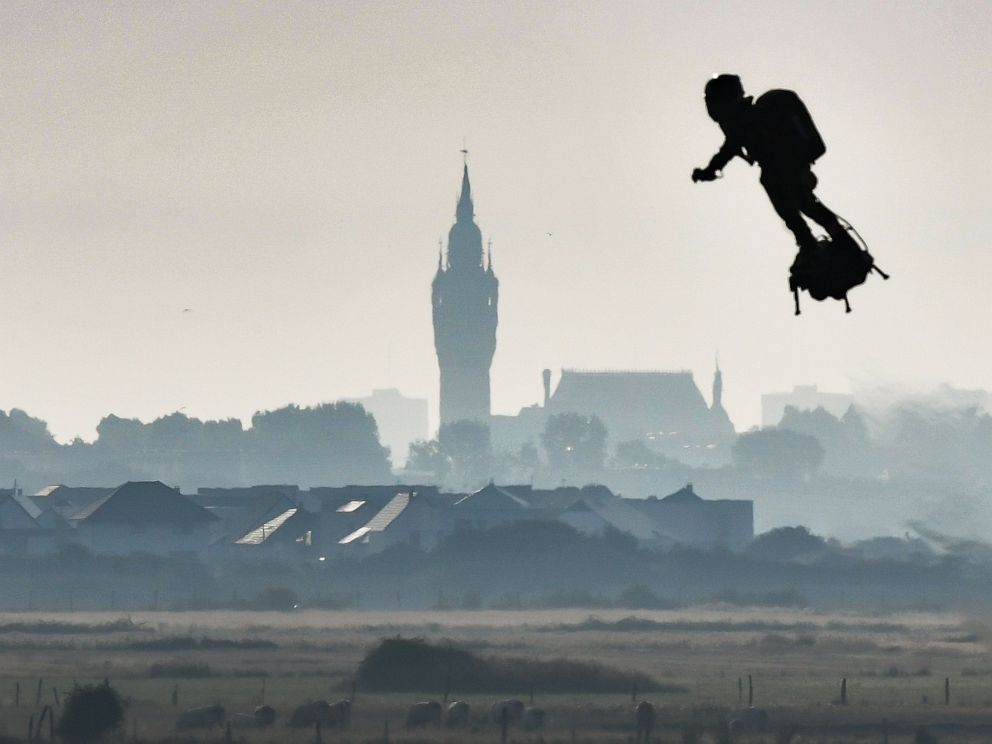 PHOTO: Franky Zapata on his jet-powered flyboard flies past the belfry of the city hall of Calais after he took off from Sangatte, northern France, on Aug. 4, 2019, during his attempt to fly across the 22-mile English Channel crossing in 20 minutes.