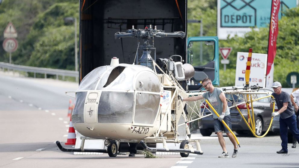 Investigators trasnport an Alouette II helicopter allegedly abandoned by French prisoner Redoine Faid and suspected accomplices after his escape from the prison of Reau, in Gonesse, north of Paris, July 1, 2018.