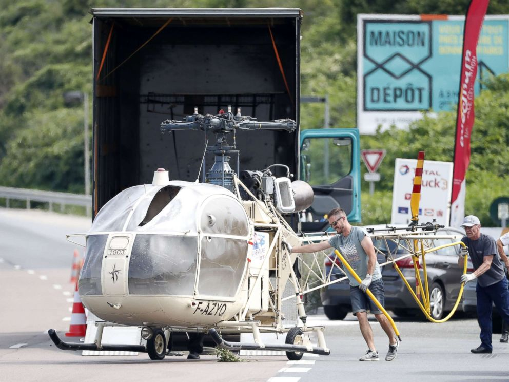 PHOTO: Investigators trasnport an Alouette II helicopter allegedly abandoned by French prisoner Redoine Faid and suspected accomplices after his escape from the prison of Reau, in Gonesse, north of Paris, July 1, 2018.