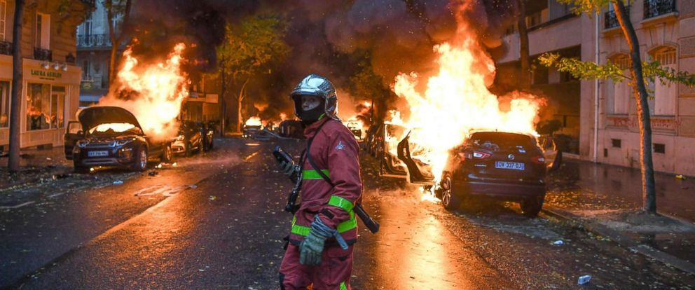 PHOTO: A firefighter at the scene of burning cars during a protest against rising oil prices and living costs, Dec. 1, 2018 in Paris.