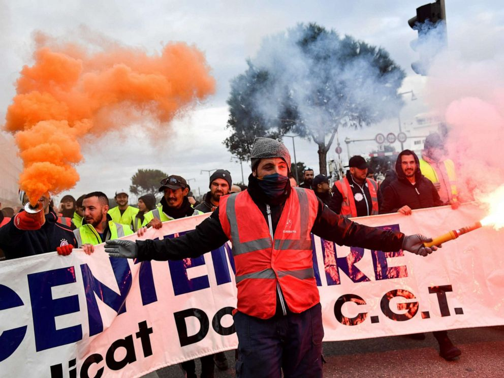 PHOTO: People march as they take part in a demonstration to protest against the pension overhauls, in Marseille, France, Dec. 5, 2019.