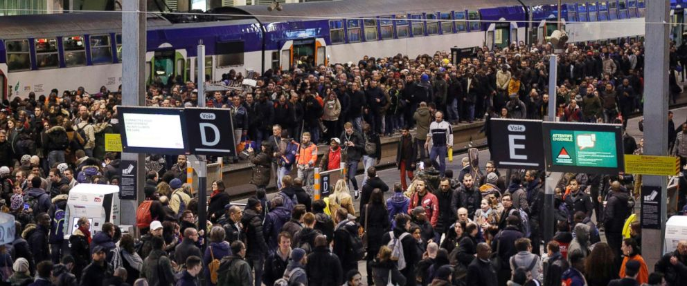 Massive strikes disrupt train travel and flights in france abc news photo passengers and commuters wait at rush hour at gare de lyon train station sciox Image collections