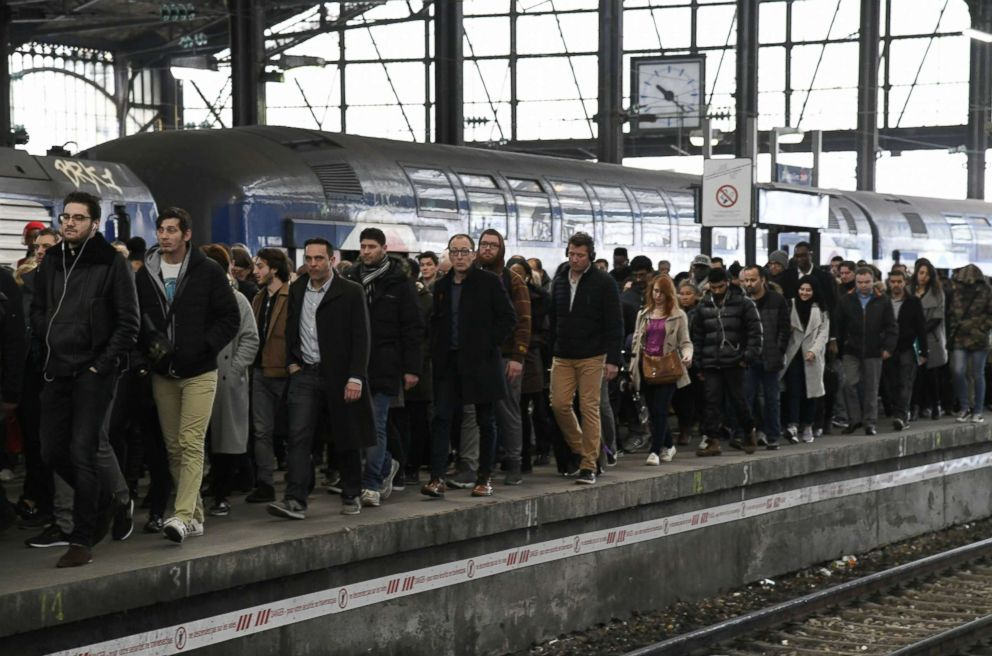 PHOTO: Commuters walk down a platform at the Saint-Lazare train station in Paris, April 3, 2018, at the start of three months of rolling rail strikes.