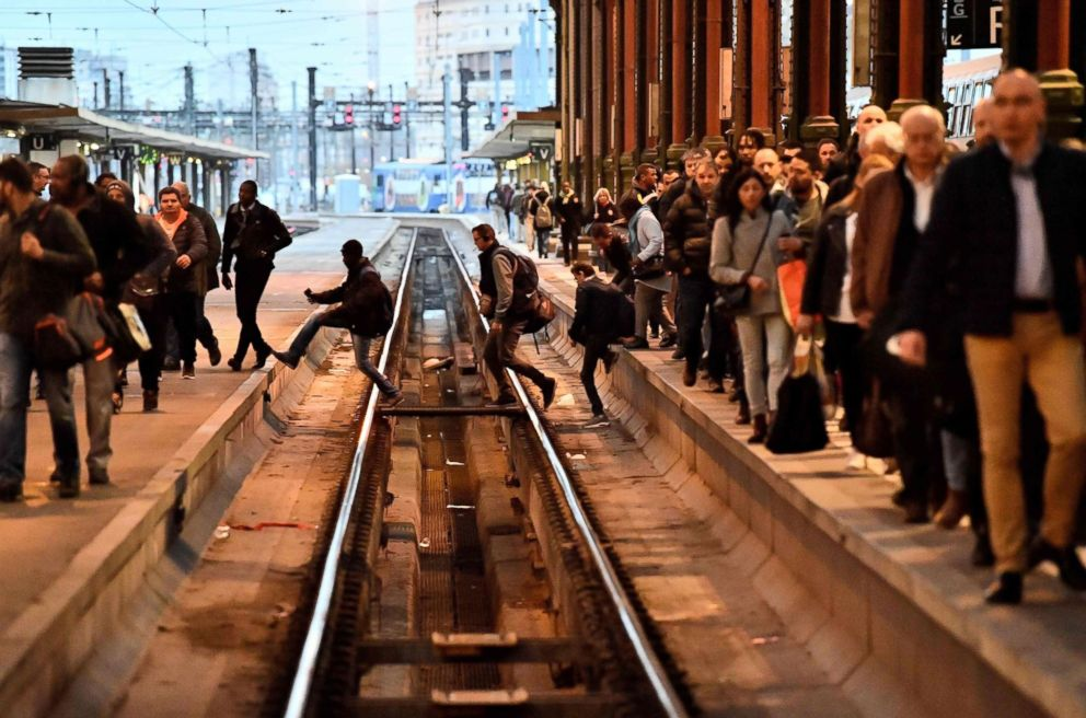 PHOTO: People cross rail tracks in a station in Paris, April 3, 2018, at the start of three months of rolling rail strikes.