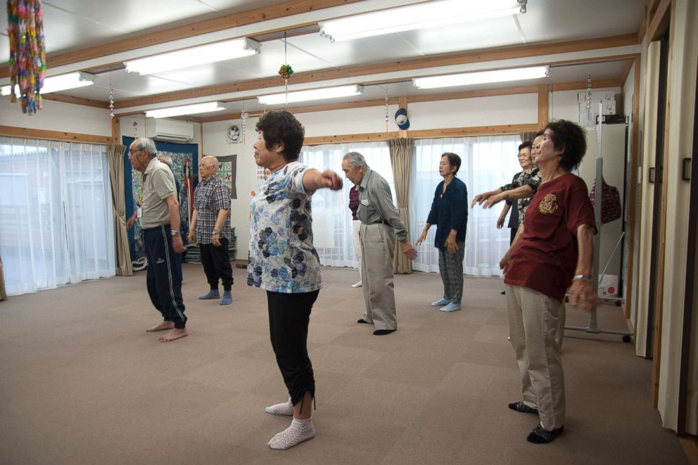 PHOTO: About a dozen senior residents participate in a morning workout at a community center of the Ushigoe Temporary Housing Complex in Minamisoma, Fukushima.