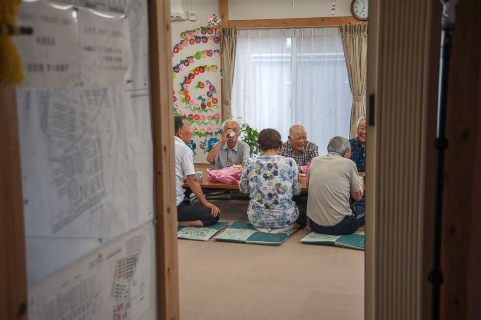 PHOTO: Senior residents chat over a cup of tea after a morning workout at a community center of the Ushigoe Temporary Housing Complex in Minamisoma, Fukushima. About 70 percent of the residents at the complex are at least 60 years old.