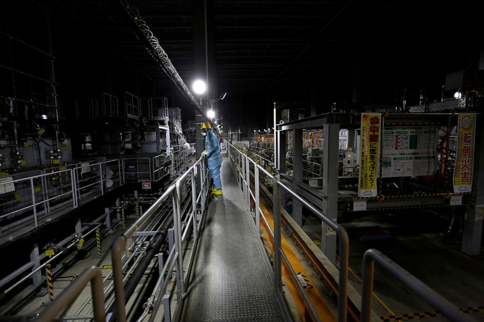 PHOTO: In this Feb. 18, 2019, file photo, an employee of Tokyo Electric Power Co (TEPCO) is shown wearing a protective suit and mask inside a radiation filtering Advanced Liquid Processing Systems at tsunami-crippled Fukushima Daiichi nuclear power plant.