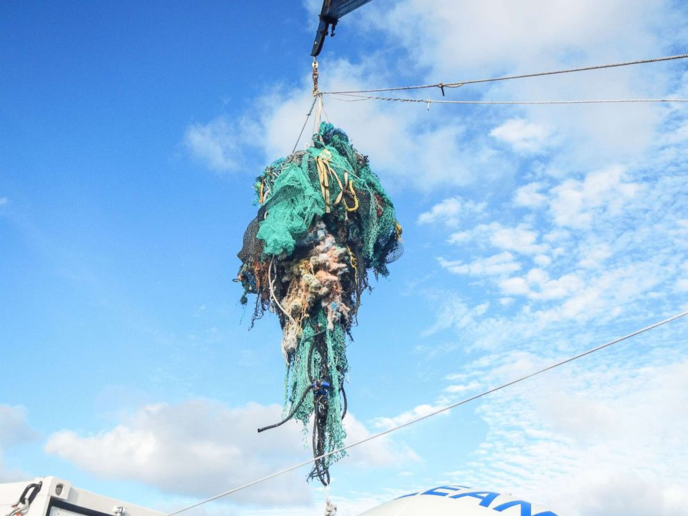 PHOTO: A photo made available by The Ocean Cleanup on March 23, 2018 shows abandoned nets and other plastic garbage being pulled out of the ocean at the Great Pacific Garbage Patch (GPGP), located between halfway between Hawaii and California.