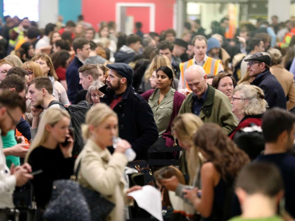PHOTO: Passengers at Gatwick airport waiting for their flights following the delays and cancellations brought on by drone sightings near the airfield, in London, Dec. 21, 2018.
