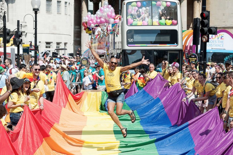 Flag bearers gather for the Pride in London parade in London, July 07, 2018.