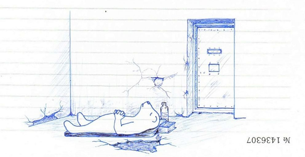 PHOTO: Gaylen lying on the cold prison floor.