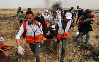 PHOTO: A wounded Palestinian protester is evacuated during clashes with Israeli security forces at the Israel-Gaza border where Palestinians demand the right to return to their homeland, April 20, 2018.