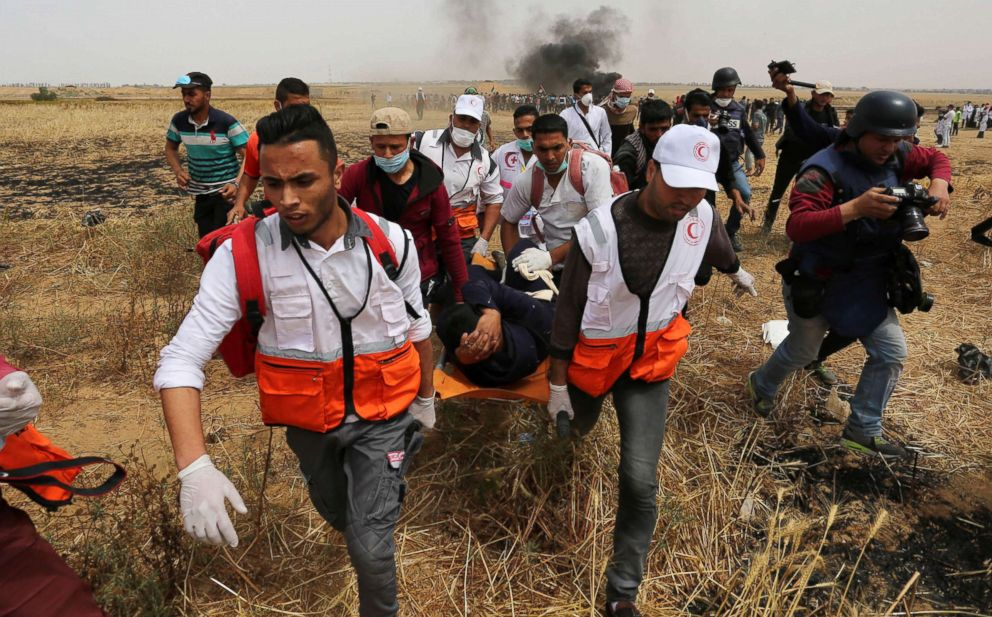 A wounded Palestinian protester is evacuated during clashes with Israeli security forces at the Israel-Gaza border where Palestinians demand the right to return to their homeland, April 20, 2018.