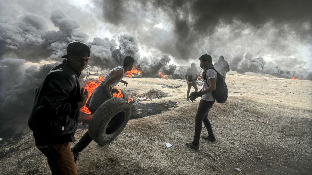 Palestinians protesters are pictured during clashes near the border with Israel in the east of Gaza City, April 20, 2018.
