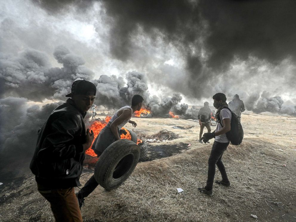 PHOTO: Palestinians protesters are pictured during clashes near the border with Israel in the east of Gaza City, April 20, 2018.