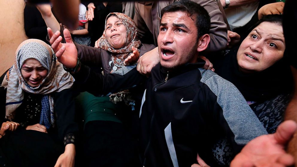 Palestinians mourn over the death of 24-year-old Mohammed al-Hamayda, during his funeral in Rafah in the Southern Gaza Strip, June 30, 2018.