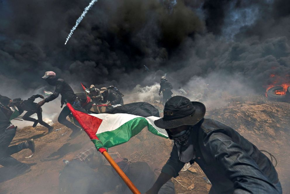 PHOTO: Palestinian demonstrators run for cover from Israeli fire and tear gas during a protest against the U.S. embassy move to Jerusalem at the Israel-Gaza border in the southern Gaza Strip, May 14, 2018.
