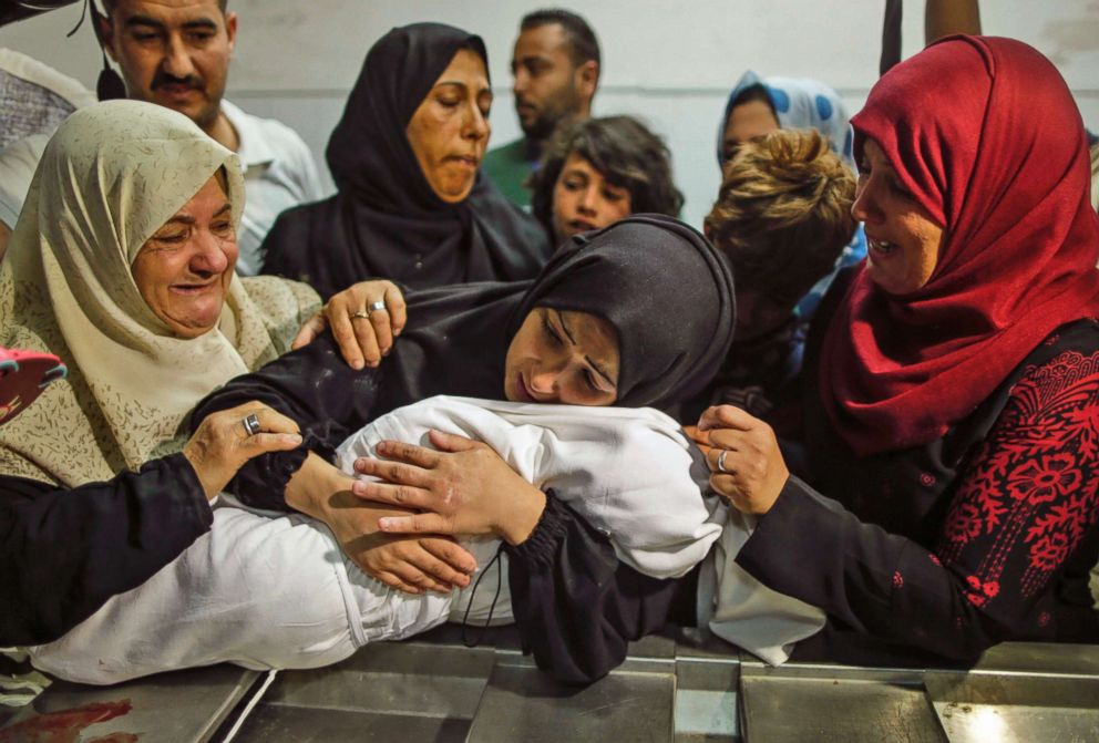 The mother of eight-month-old Leila al-Ghandour, a Palestinian child who died of tear gas inhalation during clashes in East Gaza the previous day, holds her at the morgue of al-Shifa hospital in Gaza City on May 15, 2018.