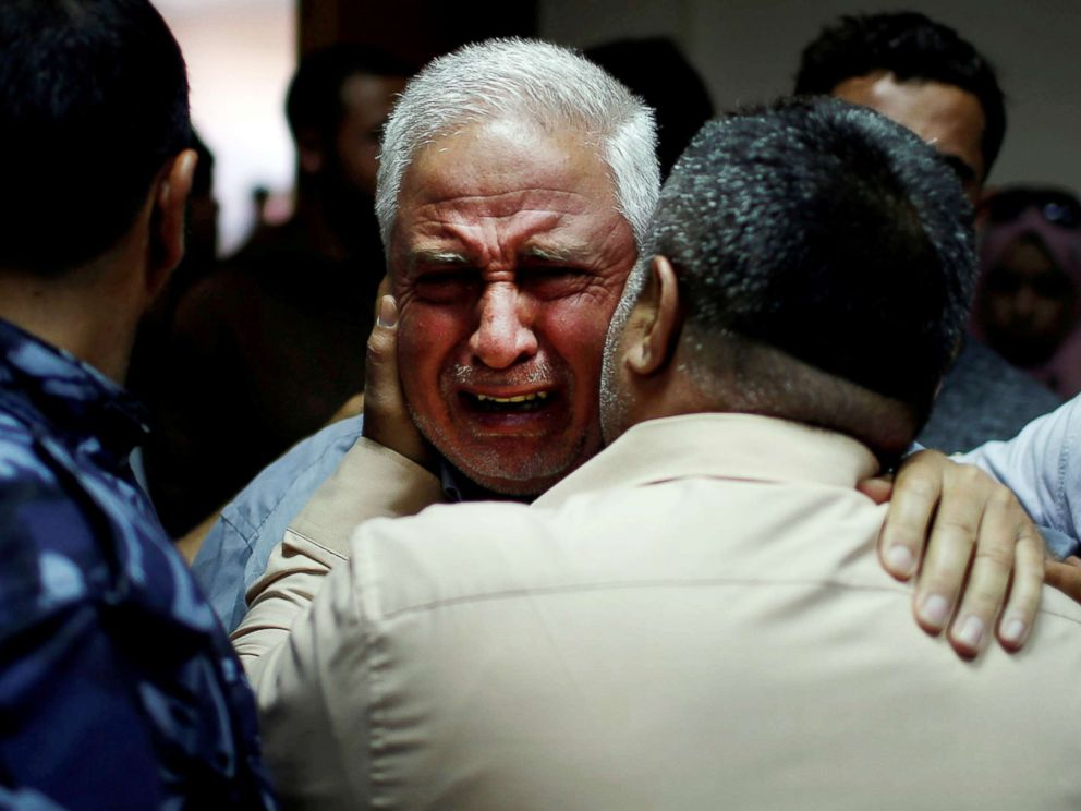 PHOTO: A relative of Palestinian Ahmed al-Rantisi, killed during a protest at the Israel-Gaza border, is consoled at a hospital in the northern Gaza Strip on May 14, 2018.