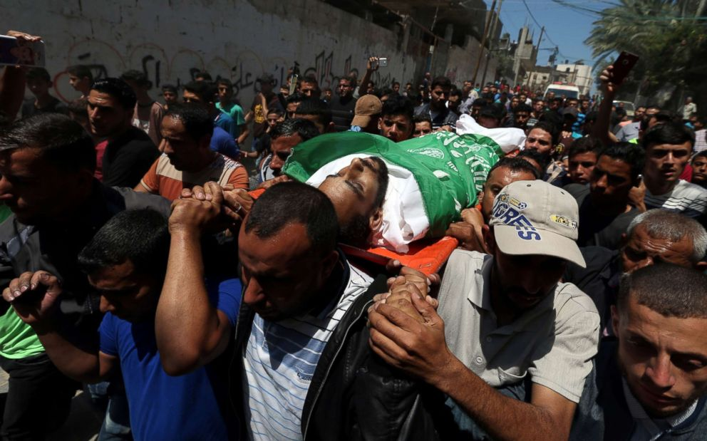 PHOTO: Mourners carry the body of a Palestinian, who was killed during a protest against the U.S embassy move to Jerusalem at the Israel-Gaza border, during his funeral in the central Gaza Strip on May 15, 2018.