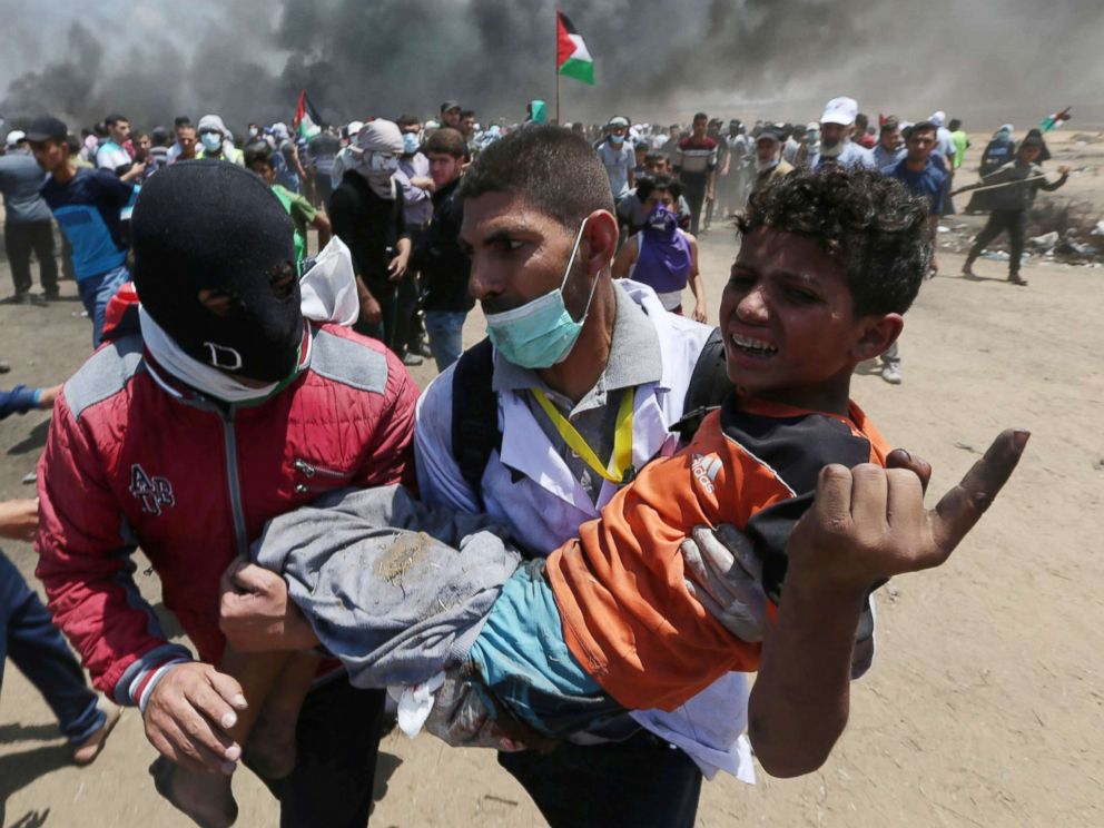PHOTO: A wounded Palestinian boy is evacuated during a protest against U.S. embassy move to Jerusalem at the Israel-Gaza border in the southern Gaza Strip, May 14, 2018.