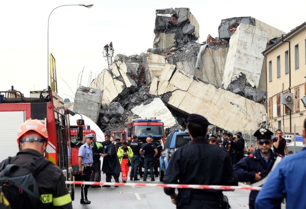 PHOTO: Rescuers work amid the rubble of a section of a giant motorway bridge that collapsed earlier, on Aug. 14, 2018 in Genoa, Italy.